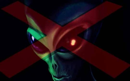 alien with red sign on his face