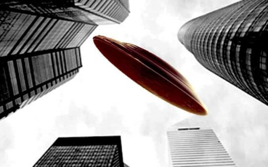 ufo flying through skyscrapers