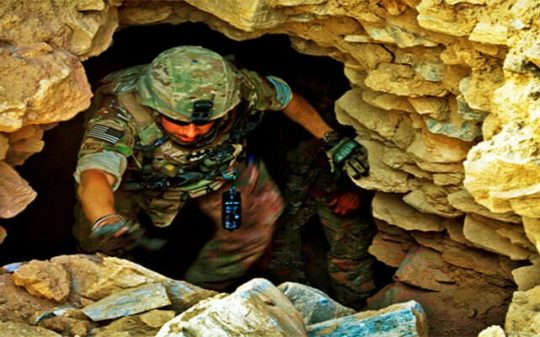us soldier climbing out of cave