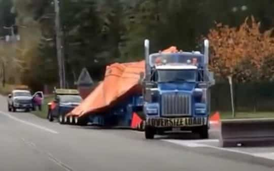 What Appears To Be A Broken Down UFO is Transported By Semi Truck